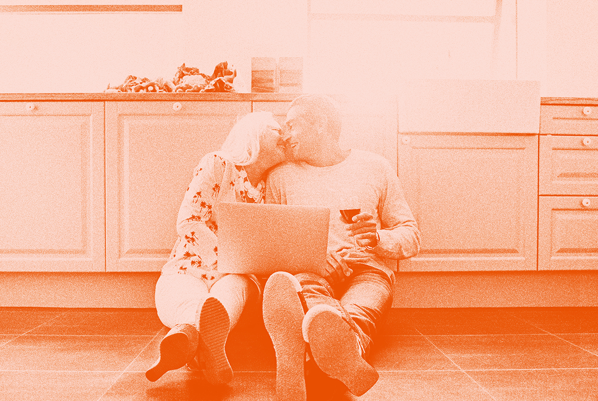 couple sitting on the floor with laptop